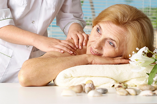 A Senior Woman Relaxing While Back Massage
